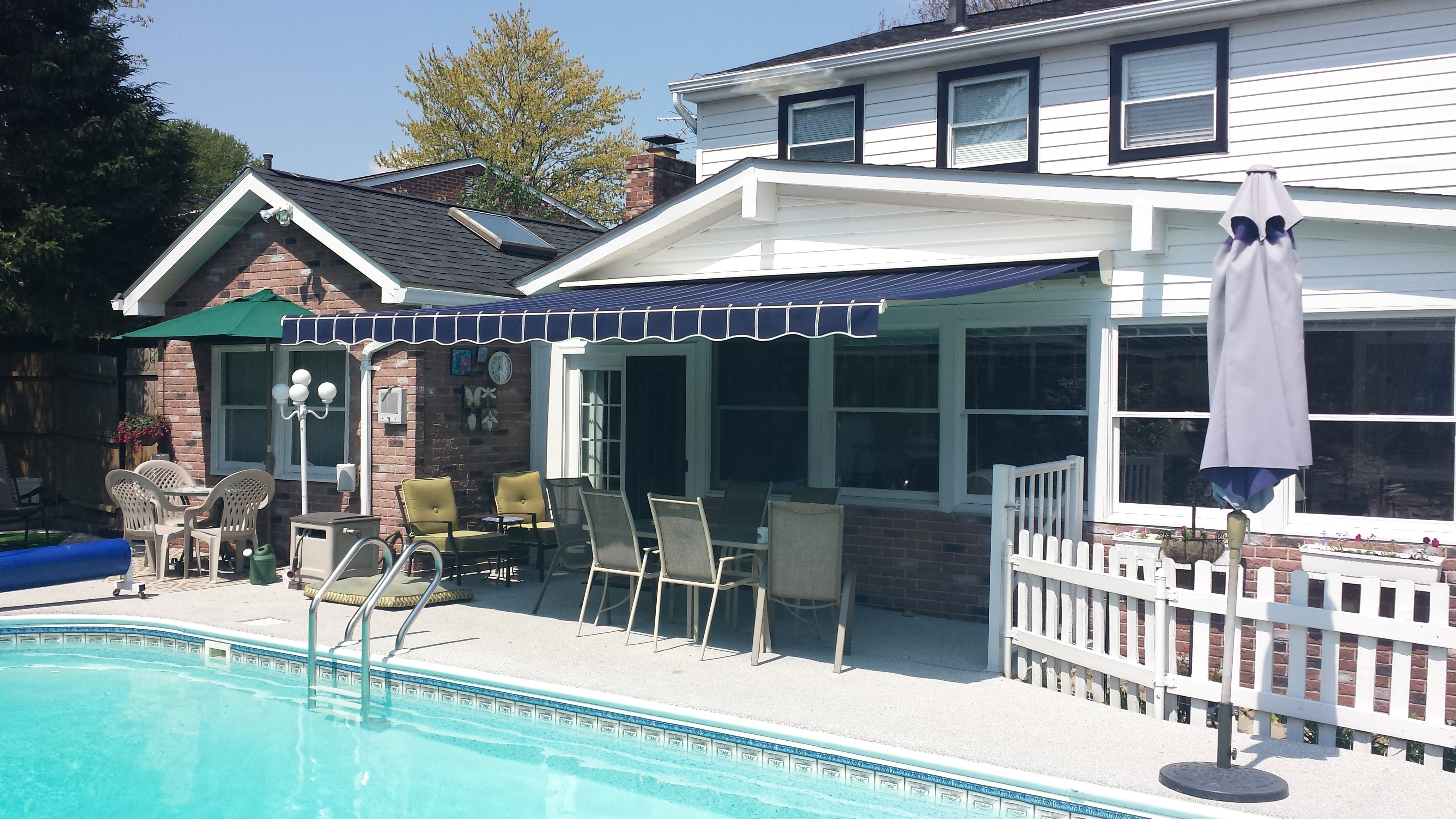 retractable replacement awning s motorized sunsetter costco fabric manual installation cost price