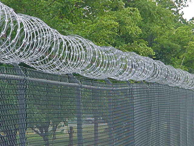 Chain link fence, with razor wire